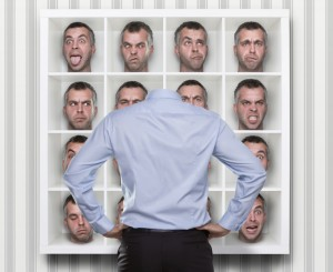 Conceptual image of young businessman choosing which face expres