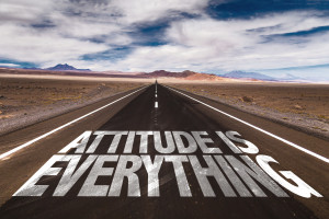 Attitude is Everything written on desert road